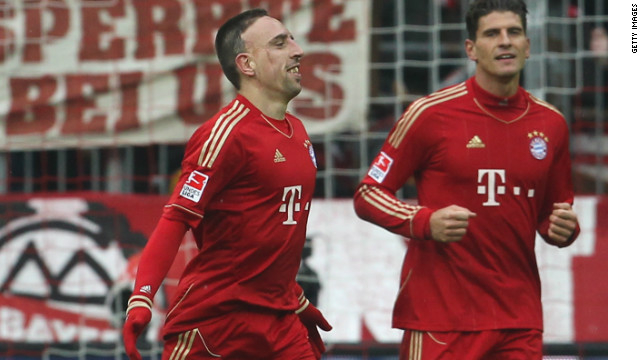 Franck Ribery celebrates with Bayern Munich teammate Mario Gomez after scoring his second goal against Schalke.