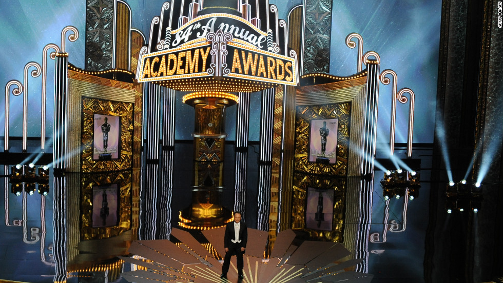 "The 84th Academy Awards kicked off in typical Billy Crystal fashion. Before singing a tune about the nominees, the nine-time host put himself into the movies -- literally. He kissed George Clooney in a scene from ""The Descendants,"" and Justin Bieber showed up in a spoof of ""Midnight in Paris."" Bieber said he was there to lower the demographic of the awards show -- specifically targeting the 18- to 24-year-olds."