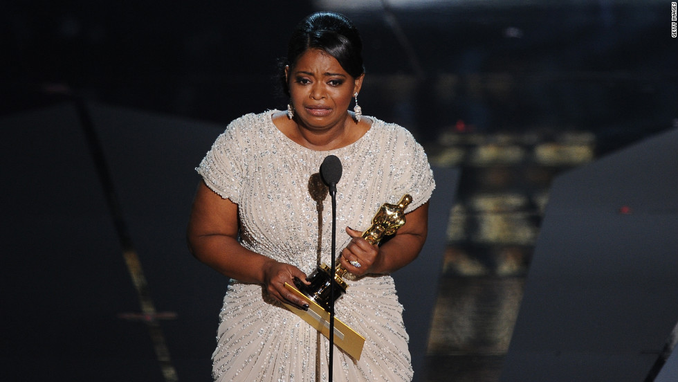 """The Help's"" Octavia Spencer seemed genuinely surprised when she won the Academy Award for best supporting actress. She was so surprised, in fact, that she needed help getting up out of her seat. She walked on stage to a standing ovation, and thanked the Academy for putting her with the hottest guy in the room -- Oscar, of course."