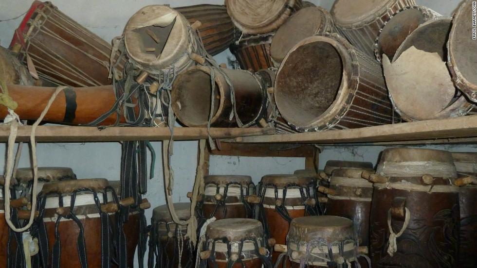 Hand made sabar drums fill a storage space in one of Doudou N'Diaye Rose's homes.