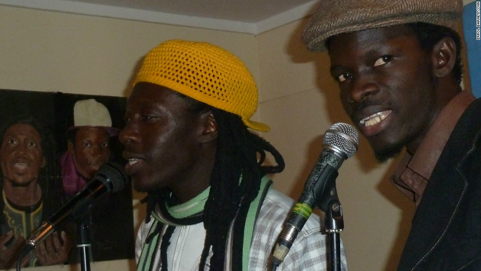 Daara J Family vocalists Faada Freddy (left) and N'Dongo D (right) in the studio.