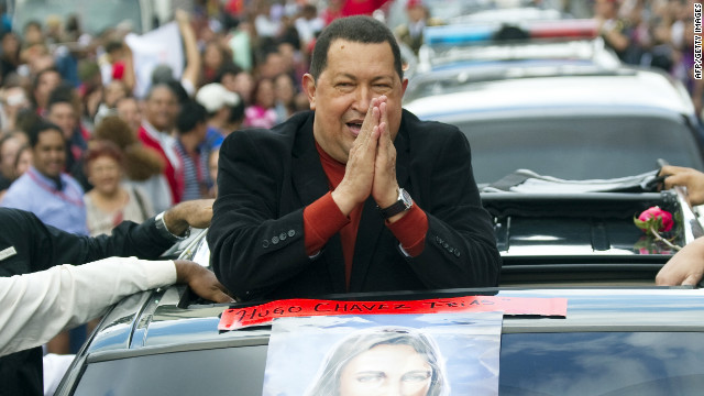 Supporters wave to Venezuelan President Hugo Chavez in Caracas on February on 24, 2012.