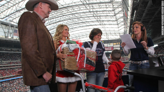 Sara Wood and her son were surprised by Dan Wallrath, left, during a Houston Texans football game this past season.