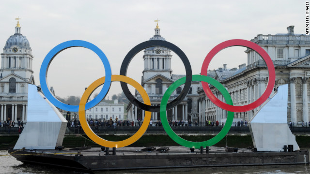 Giant Olympic rings on a barge float past the Old Royal Naval College on the Thames in London on February 28, 150 days until the start of the 2012 London Olympics.