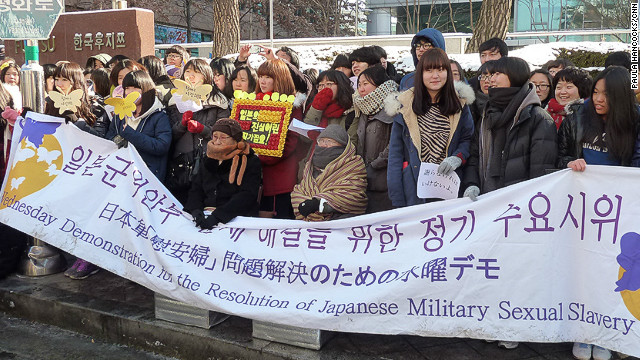'Comfort Woman' Kim Bok-dong (in brown scarf and black top) protests outside the Japanese embassy in Seoul.