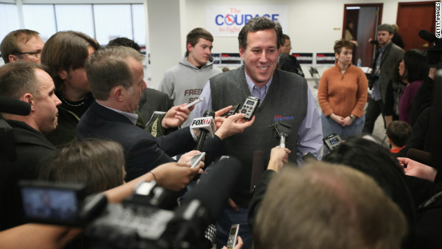 Rick Santorum talks to reporters during a visit to his campaign office in Grand Rapids, Michigan