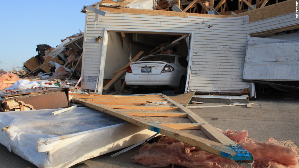 A Harrisburg neighborhood lies in ruins Thursday after a  tornado tore through the town. A monster storm system killed six people in Harrisburg and left at least seven others dead in two other states.