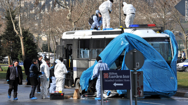 Turkish forensic police search a police bus after an explosion in Istanbul, on March 1, 2012.
