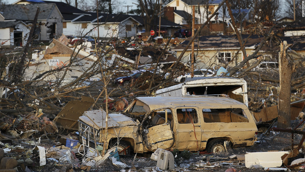 The powerful storm leaves cars tossed about among collapsed houses and other debris Wednesday in Harrisburg.
