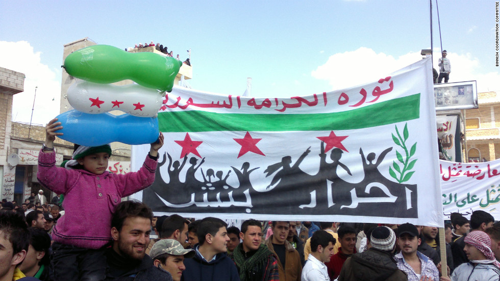 Anti-government protestors gather on Friday, March 2,  in Binnish, Syria, in  handout photos provided by the Binnish Coordination Committee. Binnish has conducted this weekly ritual of defiance for months in this opposition enclave.