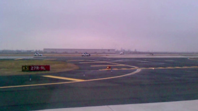 Jeep races down runway, diverts planes