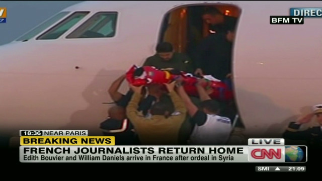 french.journalists.return.home_00001210