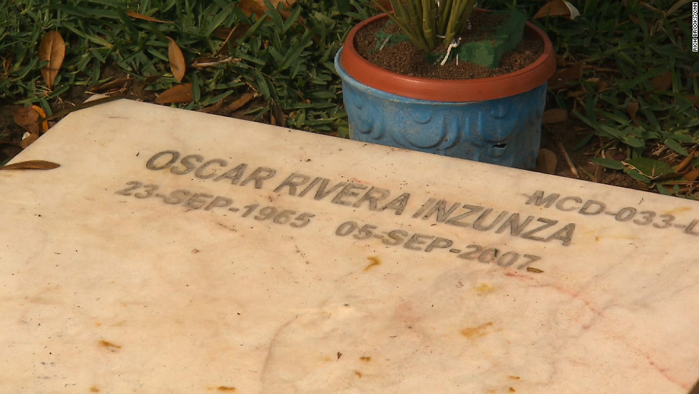 In stark contrast to the Jardines del Humaya, a stark headstone sits in a small cemetery a few miles away. Oscar Rivera, a journalist, was shot down in 2007.