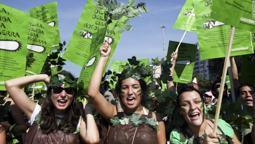 Greenpeace activists march along Rio de Janeiro's Copacabana beach ptotesting Brazil's new Forest Code in June 2011.