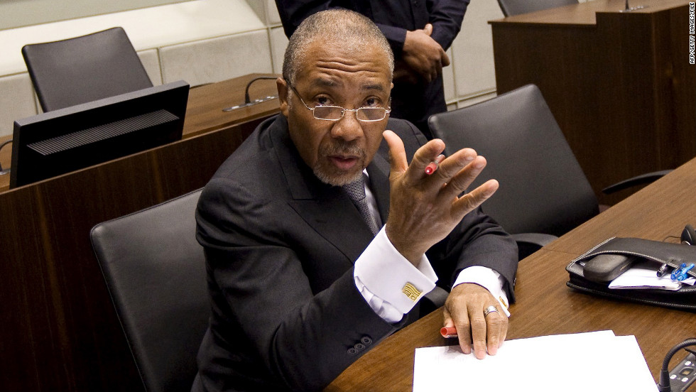 Charles Taylor waits for the start of the prosecution's closing arguments during his trial at the U.N. Special Court for Sierra Leone in February 2011.