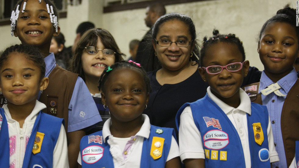 "<strong>NALDA GOMES,</strong> 43, and other volunteers lead Daisy troop 4338 (ages 5 to 6), Brownie troop 4330 (ages 7 to 8) and Junior troop 4326 (ages 9 to 10) in Queens Village in New York City. Most girls have Latino, Caribbean or African-American backgrounds. Gomes was a Girl Guide in her native Antigua, in the Caribbean, before moving to the U.S. at age 13. ""All international Girl Scouts are considered Girl Guides, only in the states are they called girl scouts,"" she explained. ""I'm a registered nurse. I work at St. Luke's Roosevelt hospital as a clinical educator."""