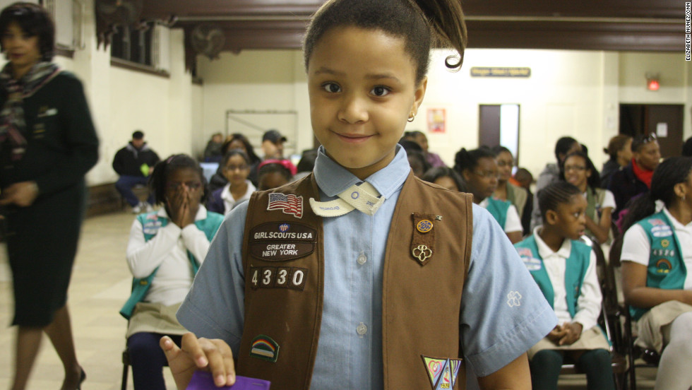 "<strong>KAITLYN JEAN-BART</strong> is eight and joined the Girl Scouts five years ago and particularly likes helping others, ""get stuff for the charity, put them in boxes and ship them off,"" she said. Her Father is Haitian and her mother is from North Carolina."