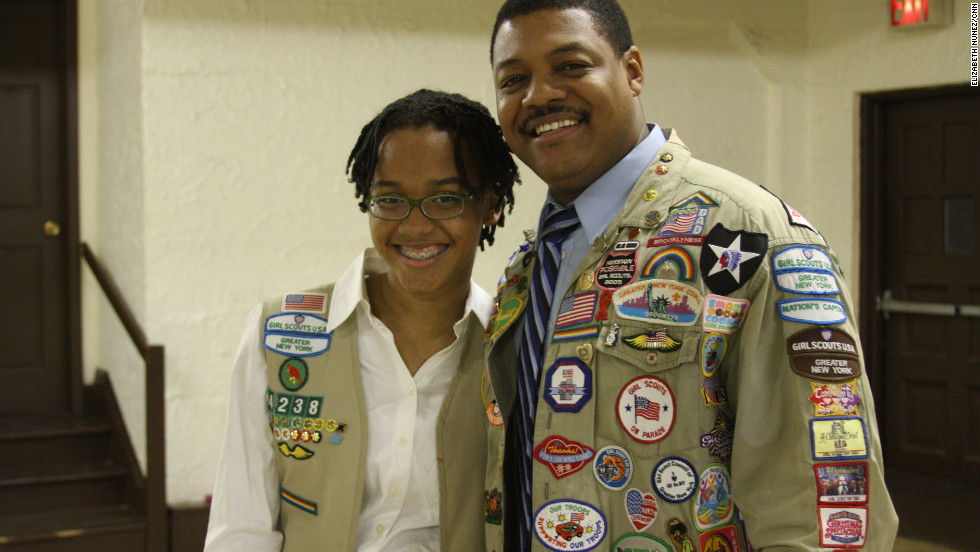 "<strong>MALCOLM ROBERTSON's </strong>four daughters have all been Girl Scouts. His third, Alexis, 16, is on her Twelfth year as a scout and is now a cadet in Queens. ""I was thinking about becoming a troop leader later but I really want to become a medical examiner first"" she said. Her father, who teaches sixth grade social studies and science, values that the girls get to do things they normally wouldn't. ""It's a good environment, it's a good way to be involved in the community and... in service"", he said."