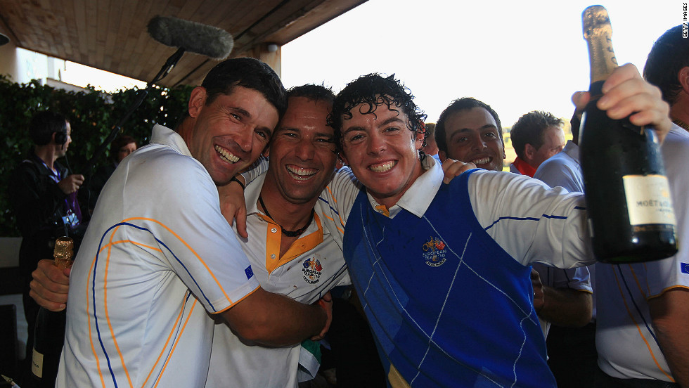 McIlroy celebrates Europe's win (by one point) over the U.S. team with teammate Padraig Harrington (left) and vice-captain, Spain's Sergio Garcia.