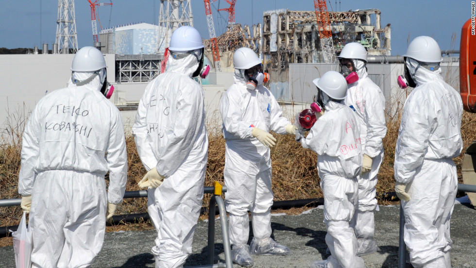A Tokyo Electric Power Co. worker describes the situation a year after the disaster at Fukushima to journalists on February 28.