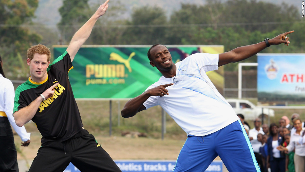 March 2012: Prince Harry poses with sprinter Usain Bolt in Kingston, Jamaica.