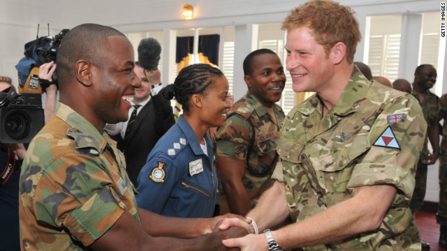 Prince Harry meets a fellow Sandhurst trainee cadet during his visit to the Up-Park Camp on March 7 in Kingston, Jamaica.