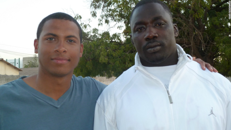 CNN's Errol Barnett with Senegalese wrestling star Gris Bordeaux.