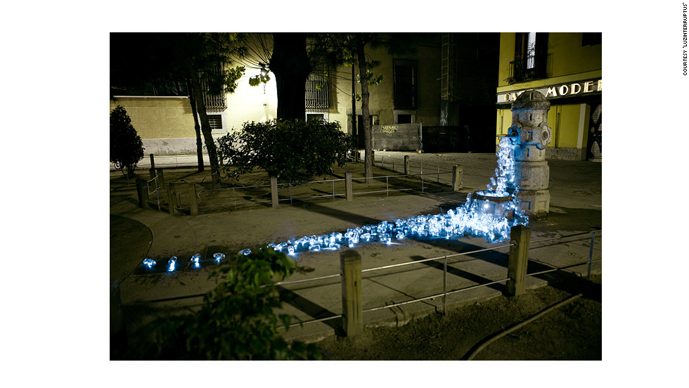 "Spanish art collective <a href=""http://www.luzinterruptus.com/"" target=""_blank"">Luzinterruptus</a> recently created a temporary installation of recycled glass containers streaming from dismantled public fountains in the streets of Madrid. They say the luminous works of art is are interventions -- designed not only to look beautiful, but to bring attention to the lack of water facilities in public spaces in Spain's capital."