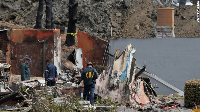 Law enforcement officials sift through rubble after a natural gas explosion in San Bruno, California, in September 2010.