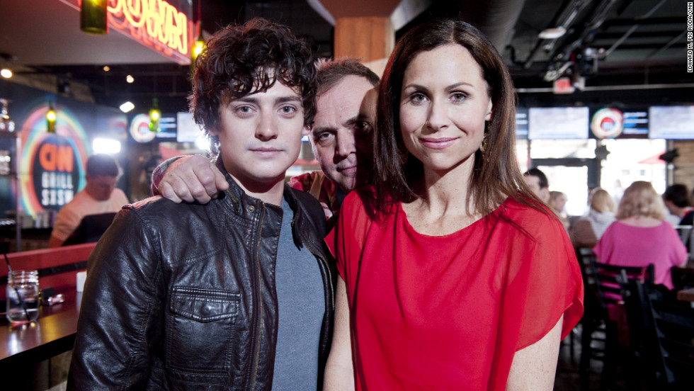 "Actor Aneurin Barnard, director Mark Evans and actress Minnie Driver pose for a photo at the CNN Grill. The three worked together on the 2011 film ""Hunky Dory."""