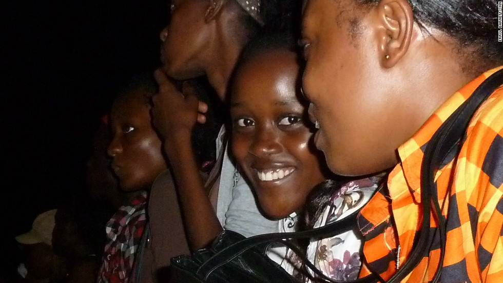A young Gabonese girl smiles to the camera during a hip hop concert.