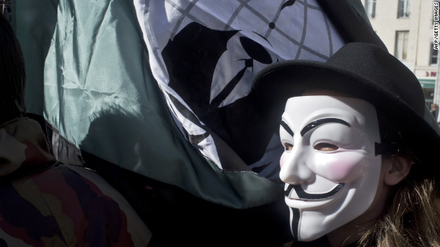 A protester wears an Anonymous mask to a rally in France.