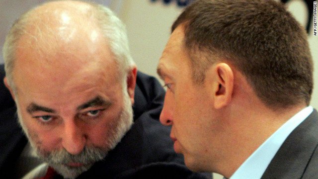 Viktor Vekselberg, left, talks to the Rusal chairman Oleg Deripaska during a press conference in Moscow in October 2006.