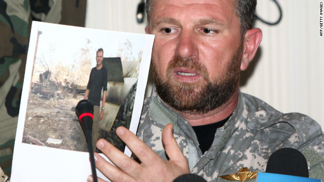The commander of the Swehli militia in Misrata, holds a picture of a British journalist during a press conference in Tripoli on March 4, 2011.