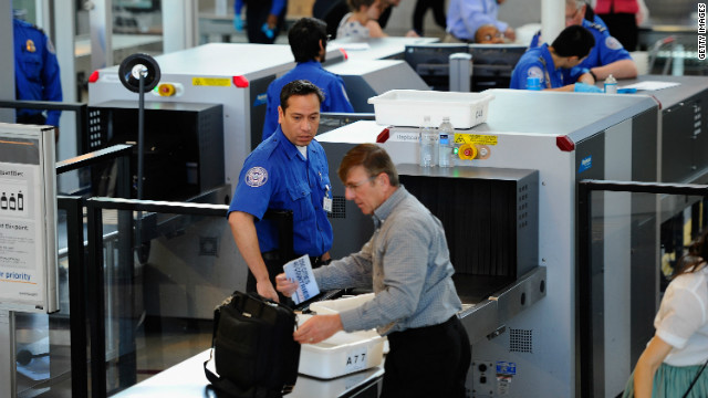 LOS ANGELES, CA - MAY 02: Transportation Security Administration (TSA) agents screen passengers at Los Angeles International Airport on May 2, 2011 in Los Angeles, California. Security presence has been escalated at airports, train stations and public places after the killing of Osama Bin Laden by the United States in Abbottabad, Pakistan. (Photo by Kevork Djansezian/Getty Images)