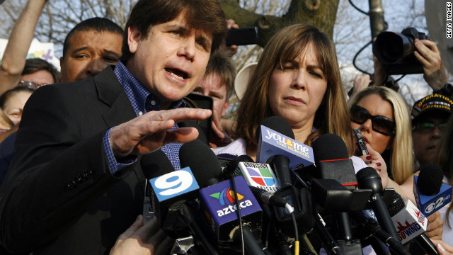 CHICAGO - MARCH 14: Disgraced former Illinois Governor 2 (L) gestures while speaking at a news conference outside his home March 14, 2012 in Chicago. Blagojevich must report to a federal prison in Colorado by tomorrow, to start serving a 14-year term he received for his conviction on numerous counts of fraud and corruption including attempting to sell the vacant U.S. Senate seat held by then Senator Barack Obama. (Photo by Frank Polich/Getty Images)