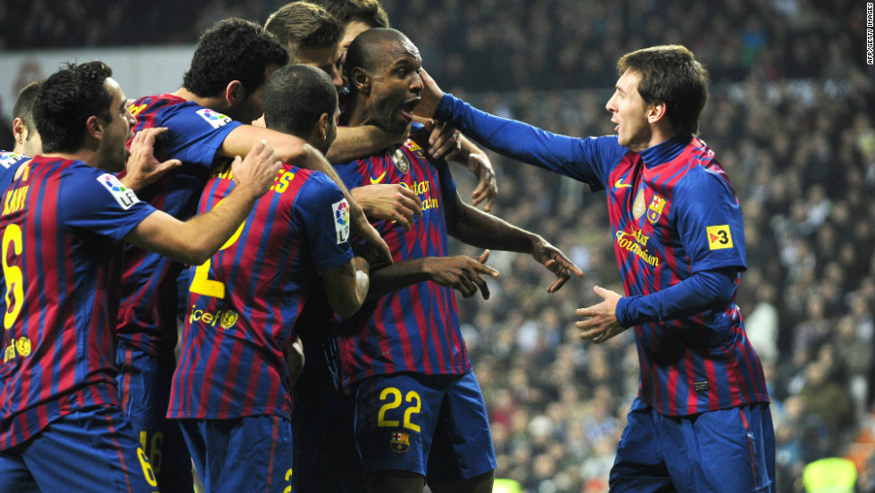 The 32-year-old has continued to be a key player for the Catalan club. Here he is surrounded by his teammates after scoring in a win against archrivals Real Madrid in January 2012.
