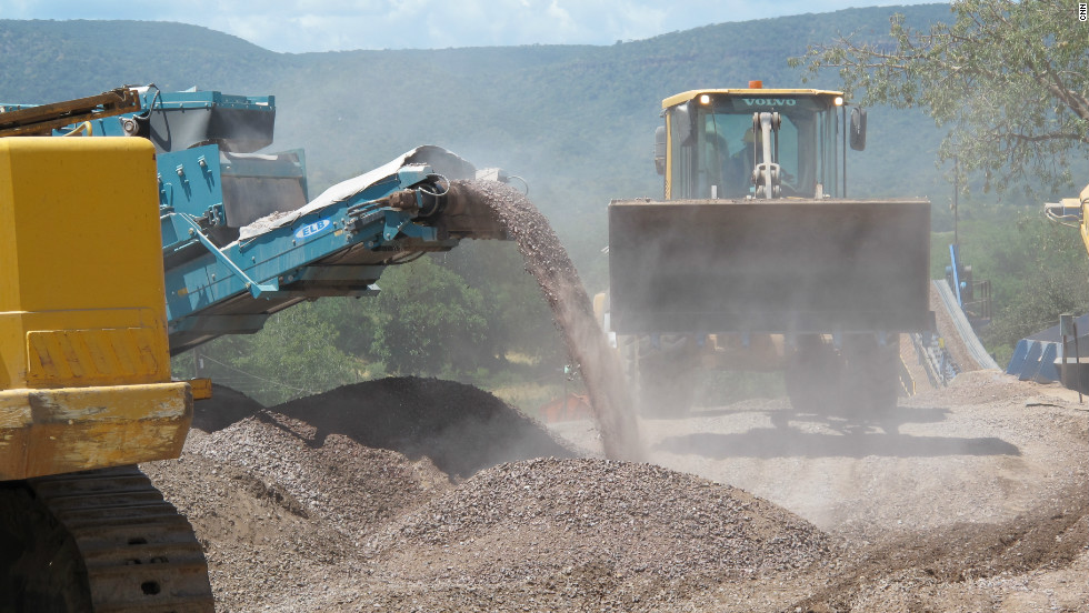 Vehicles moving earth in a mine owned by Marange Resources, one of the four companies operating in the area.