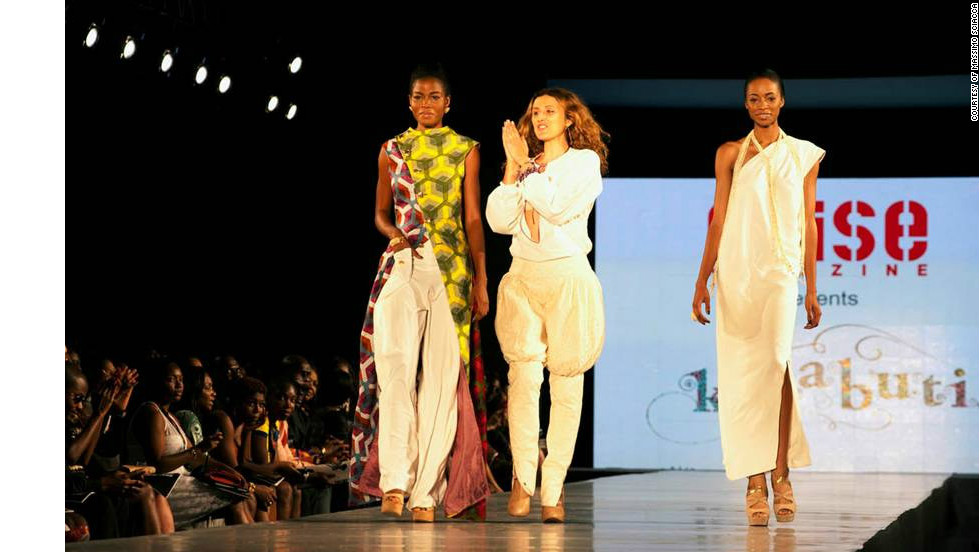 Caterina Bortolussi (center), designer for Kinabuti, joins the models on stage at the end of her show.