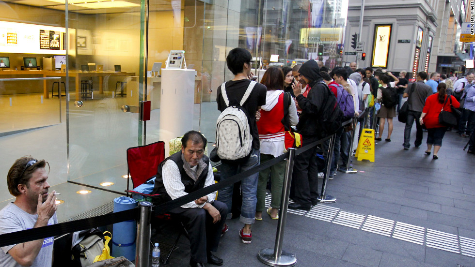 Fans line up outside an Apple Store in Sydney as Australians become some of the first people in the world to get their hands on the new iPad.
