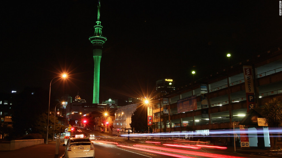 The Sky Tower in Auckland, New Zealand, is lit to mark the festivities.