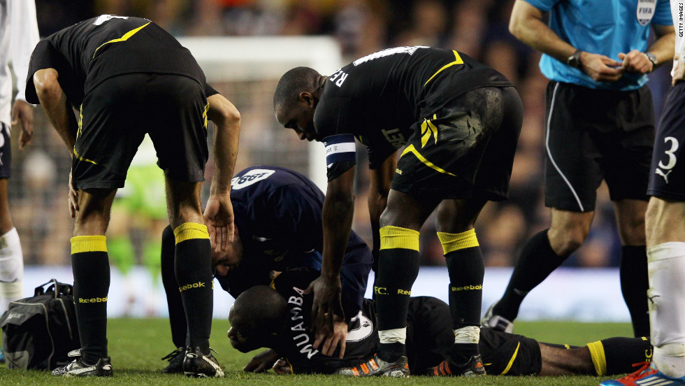Bolton player Fabrice Muamba  lies prone on the pitch after collapsing before halftime during the English FA Cup quarterfinal away to Tottenham Hotspur on Saturday.