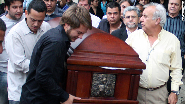 Chilean Honorary Consul Fernando Berendique, right, on Saturday helps carry the coffin of his daughter, who was shot dead in her car.