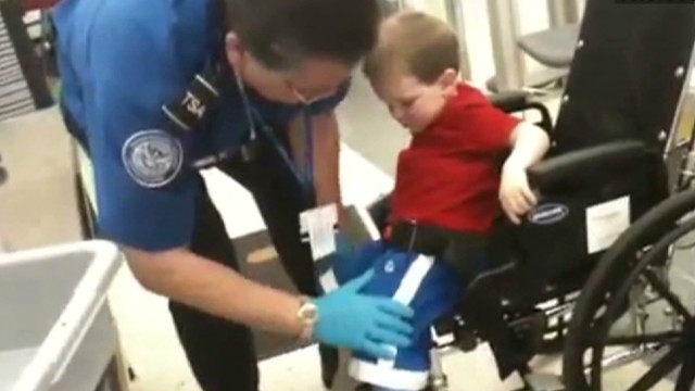 wheel chair kid tsa pat down_00001626