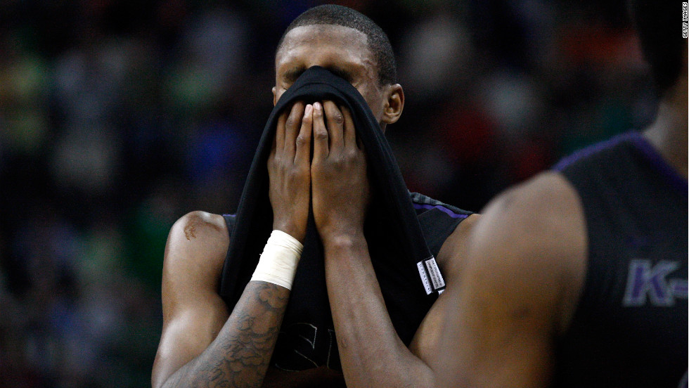 Jordan Henriquez of the Kansas State Wildcats covers his face with his jersey after losing to the Syracuse Orange 75-59 during the third round on March 17.