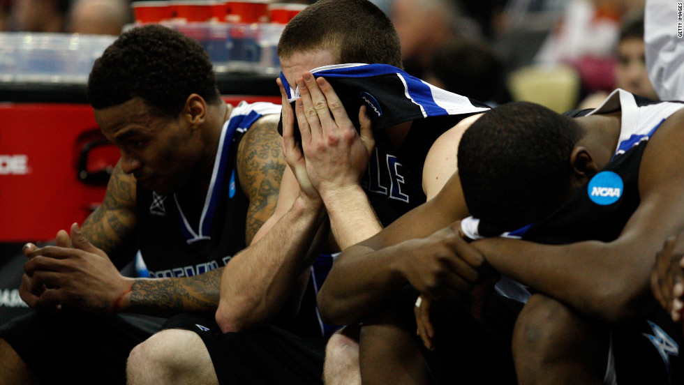Matt Dickey, center, and the UNC Asheville Bulldogs sit on the bench during a loss to the Syracuse Orange during the second round on March 15.