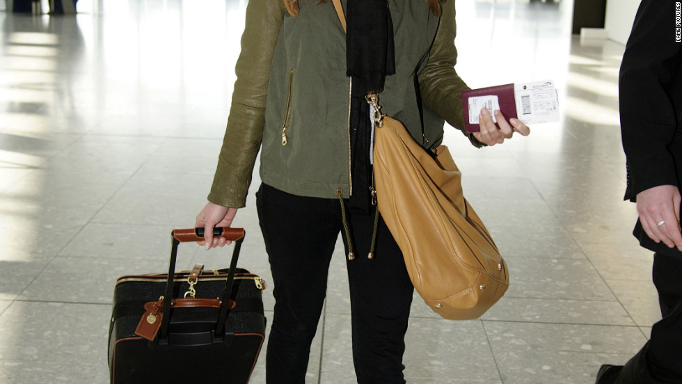 Cat Deeley catches a flight from London.
