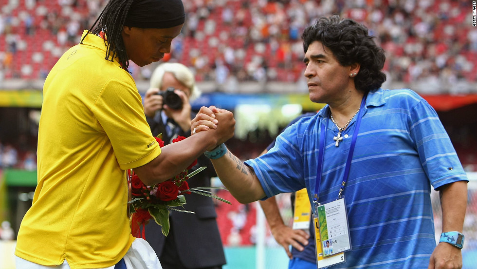 Brazil star Ronaldinho greets Argentina great Diego Maradona after receiving his bronze medal at the 2008 Beijing Olympics. The former Barcelona star has been included as an overage player in Brazil's provisional squad for London 2012.