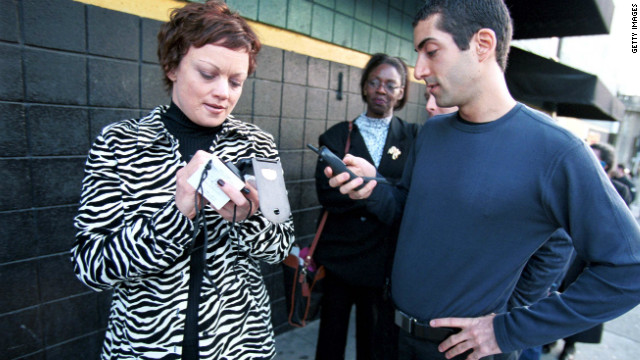 Jennifer Walker, left, a high tech public relations recruiter stands in line with Ward Karson while waiting to get into Pink Slip Party IV