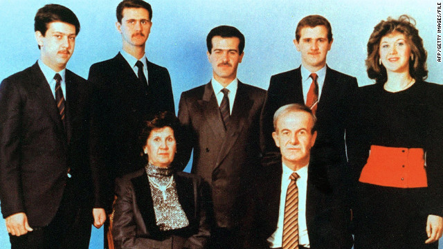 An undated photo shows former Syrian President Hafez al-Assad seated with his wife, Anisa. Behind them from left to right are children Maher, Bashar, Basel, Majd and Bushra.